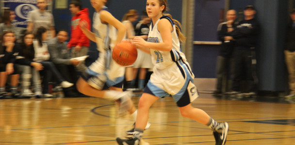 Sophomore Moriah Luthy takes the ball down the court.