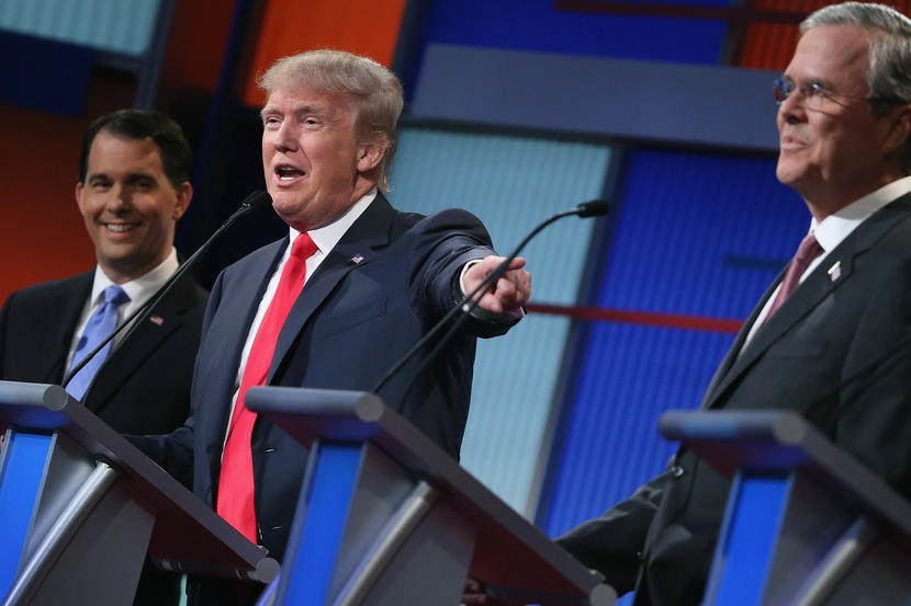 CLEVELAND, OH - AUGUST 06:  Republican presidential candidates (L-R) Wisconsin Gov. Scott Walker, Donald Trump and Jeb Bush participate in the first prime-time presidential debate hosted by FOX News and Facebook at the Quicken Loans Arena August 6, 2015 in Cleveland, Ohio. The top-ten GOP candidates were selected to participate in the debate based on their rank in an average of the five most recent national political polls.  (Photo by Chip Somodevilla/Getty Images)