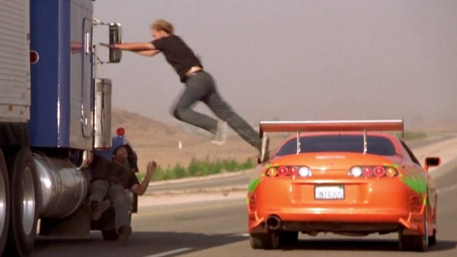 Paul Walker's character from the original film The Fast and The Furious,  jumping from his car to a truck, just like the heists currently happening