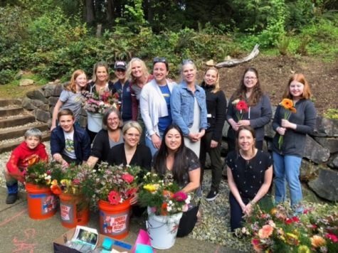 Volunteers help assemble flower bouquets for The Mayday Foundation's fundraiser in 2019.